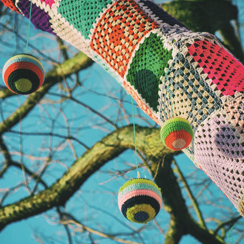Yarn,Bomb,Tree,With,Baubles,In,The,Winter,With,Blue